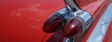 Rückleuchten roter Cadillac 3840X1440
